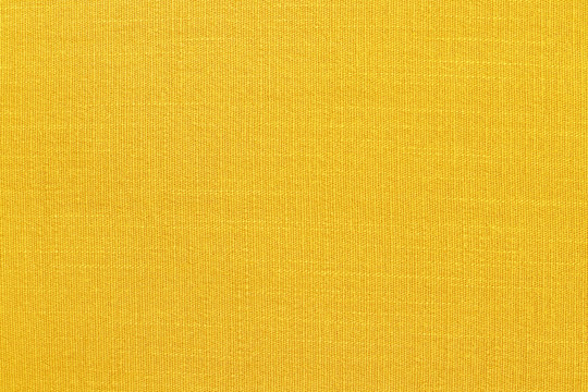 Yellow linen fabric cloth texture background, seamless pattern of natural textile.