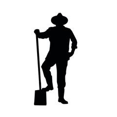 Fototapeta Silhouette of farmer posing with a shovel
