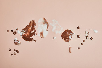Papiers peints Montagne top view of melted brown and white ice cream on pink background