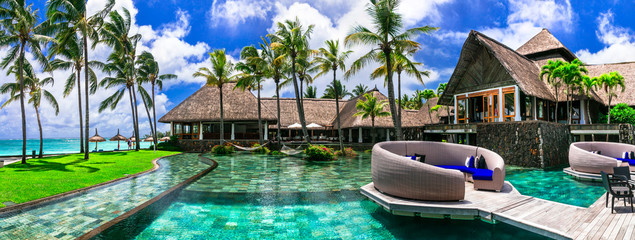luxury 5 star resort territory with swimming pool and exotic bar - Constance Belle Mare Plage. Mauritius island. Pointe de flacq , Belle Mare. February 2020