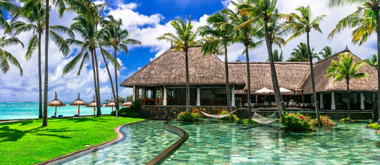 Relaxing holidays in tropical paradise in Mauritius island. lounge bar with swim pool and hammoks. Constance Belle Mare Plage. Mauritius island. Pointe de flacq , Belle Mare. February 2020