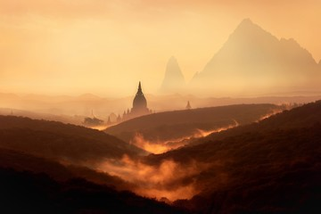 Garden Poster Brown Silhouette of a temple surrounded by hills with a tall mountain and an orange sky in the background