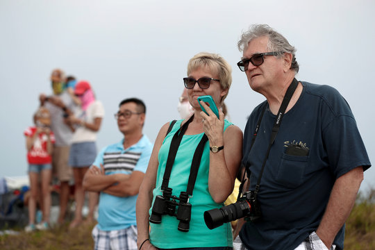 People wait to watch the launch of a SpaceX Falcon 9 rocket and Crew Dragon spacecraft during the NASA's SpaceX Demo-2 mission before the launched was called off due to threatening weather conditions in Cape Canaveral