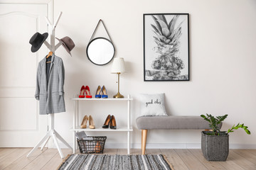 Stylish interior of modern hall with shoes on stand and bench Fotobehang