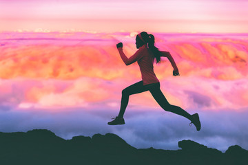 Papiers peints Rose clair / pale Trail running woman athlete runner exercising in mountains landscape background at sunset with pink color sky clouds.