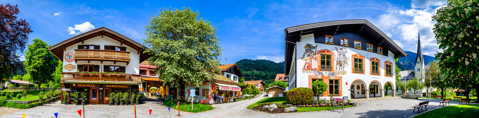 Bayrischzell, Germany - May, 19: old bavarian buildings and church at the old town of Bayrischzell on May 19, 2020
