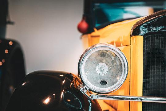 Close Headlamp Of Yellow Retro Vintage Oldtimer Car