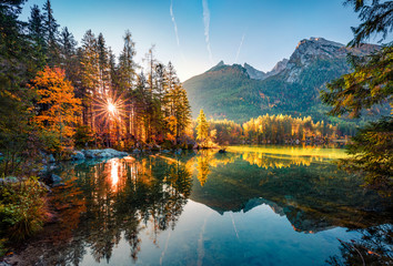 Majestic autumn view of Hintersee lake with Hochkalter peak on background, Germany, Europe. Gorgeous morning view of Bavarian Alps. Beauty of nature concept background. Fotomurales