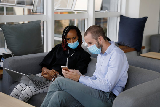 Jason Carmichael, Chief Executive Officer and Co-Founder and Dr. Muthoni Karanja Lead Medical Consultant from the Nairobi-based TIBU startup, speak in their office in Nairobi