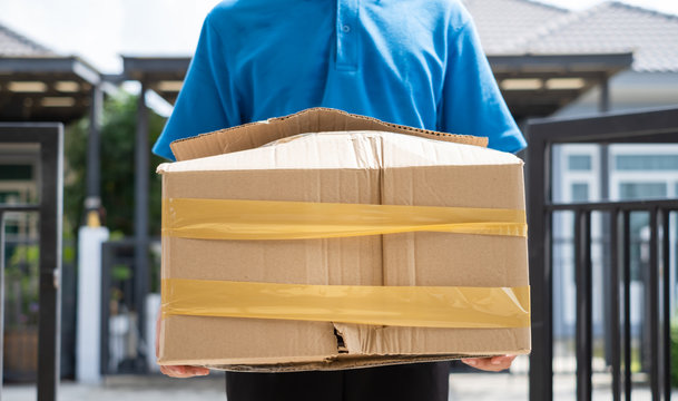 Delivery man Frightened with cardboard box damaged broken accident before delivering to customers at home, Express service client online shopping comfortable payment package product.
