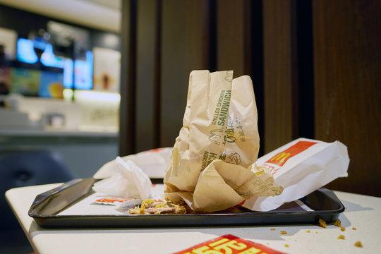 SHENZHEN, CHINA - CIRCA DECEMBER, 2016: left food tray at McDonald's restaurant. McDonald's is an American hamburger and fast food restaurant chain.