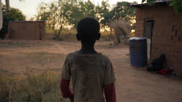 African boy walking. Zambia, Africa