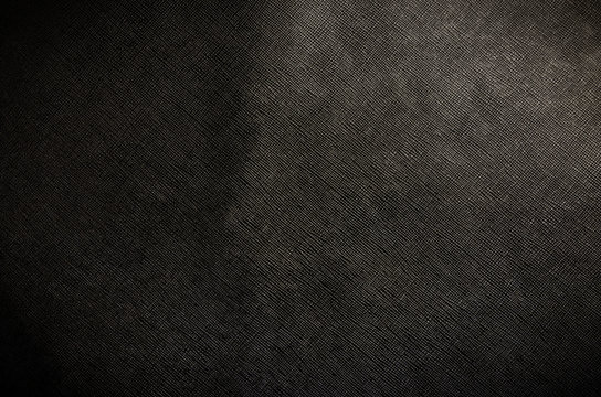 The black cattle skin texture with empty place for text top view, background for your text. Flat lay