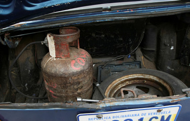 A cooking gas canister is pictured at the trunk of a car, that runs with cooking gas instead of fuel, as Venezuelans struggling to cope with chronic fuel shortage, in Maracaibo