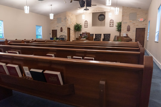 Shot of inside of empty church at worship service