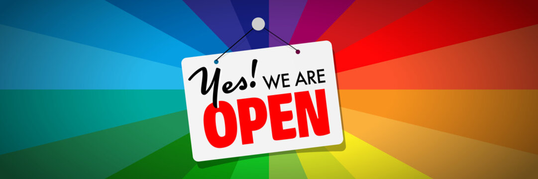 Yes, we're open sign on colorful banner