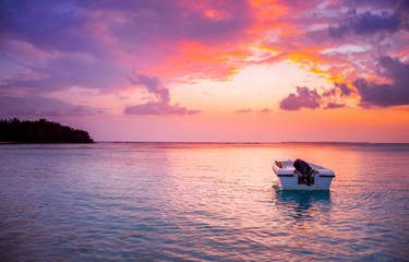 Poster Prune Maldives Island Dramatic colorful beach scenery with alone boat beautiful sunset view from Maldive world famous travel and tourism destination Trending color relaxation concept image