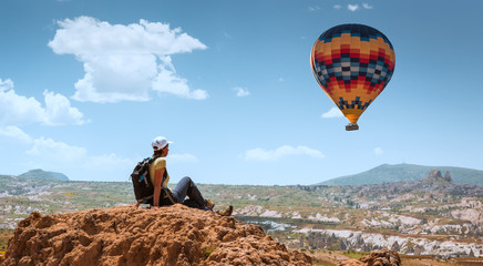 successful sporty woman in Cappadocia with hot air balloons Concept of motion motivation inspiration