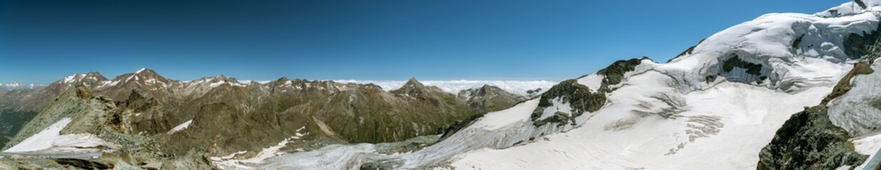 Wall Mural - Panoramic view on Swiss Alps and Fee glacier as seen from Mittelallalin above the Saas-Fee