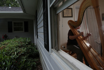 A professional musician practices in her home as the coronavirus disease (COVID-19) outbreak continues in Maryland, U.S.