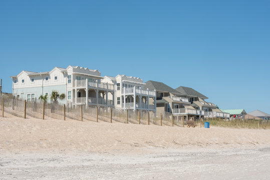 Oceanfront property along the shore of a nearly deserted Wrightsville Beach