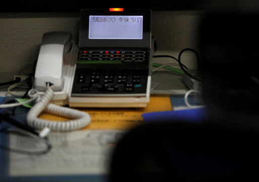 Blinking red light is seen on a phone to notify an incoming call at the Tokyo Befrienders call center during the spread of the coronavirus disease (COVID-19), in Tokyo