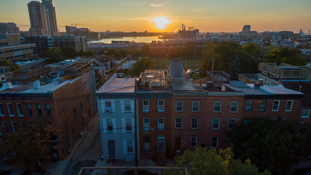 Aerial of the sunrise over the Federal Hill neighborhood in Baltimore, Maryland.