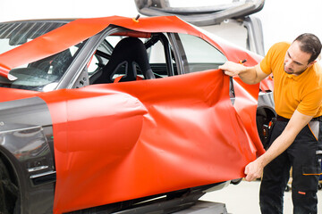 Carwrapping with red adhesive film