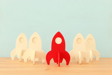 rocket leadership concept. red rocket as leader of the group. idea of standing out of the crowd