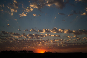 time lapse clouds over the field. Summer Sunset Fotobehang
