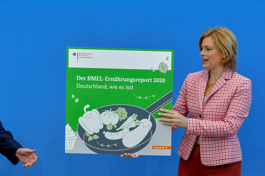 German Minister for Food and Agriculture Julia Kloeckner presents a placard at the beginning of a news conference about the 2020 Nutrition Report in Germany, in Berlin