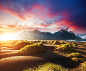 Wall Mural - Majestic view of Stokksnes cape on sunset. Location place Vestrahorn (Batman Mount), Iceland, Europe.