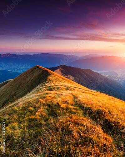 Wall mural wonderful sunset in mountain