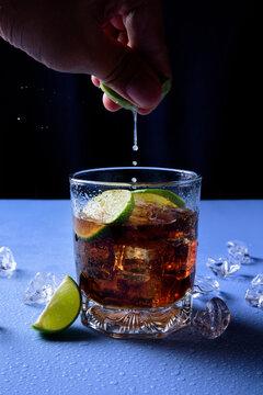 Glass of coke with lemon