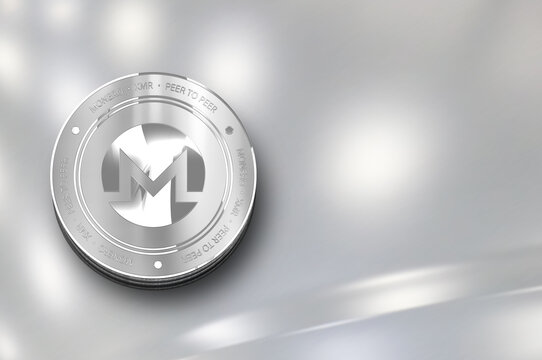 Monero (XMR) digital crypto currency. Silver coin. Cyber money.