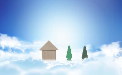 青空と雲と積み木の家