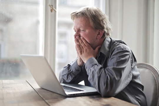 desperate man with computer at home