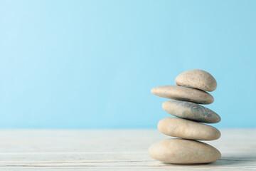 Photo sur Toile Zen pierres a sable Pile of stones on wooden table. Zen concept