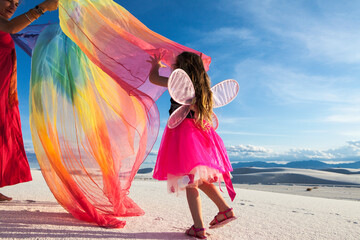 rainbow, streamer, kite, running, fairies, childhood, mother playing with her 4 year old daughter dressed as a fairy, White Sands, Nat'l Monument, NM, families, togetherness, love