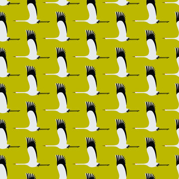 Flying cranes flock - side view. Seamless pattern design in mustard color pallet