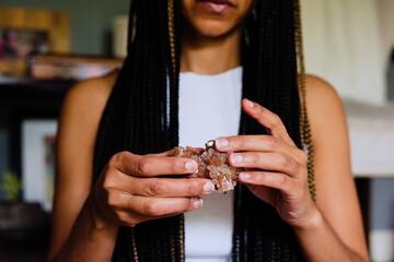 Woman holding healing crystals