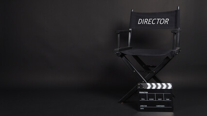 Director chair and Clapper board or movie slate use in video production or movie and cinema industry. It's black color.