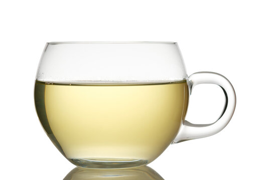 Glass cup of green tea white isolated