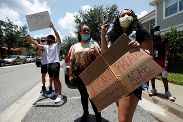 Protesters gather outside the Florida home of former Minneapolis police officer Derek Chauvin, in Orlando