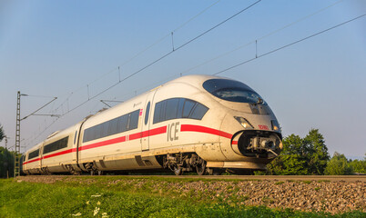 OFFENBURG, GERMANY - JULY 10: Intercity Express train of Deutsche Bahn on JULY 10, 2013 in Offenburg, Germany. DB AG carries about two billion passengers each year.