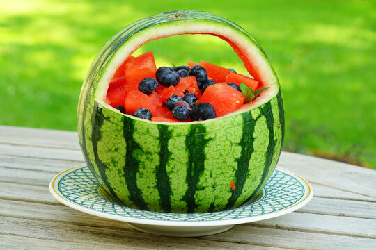 Watermelon and blueberry salad in a watermelon basket