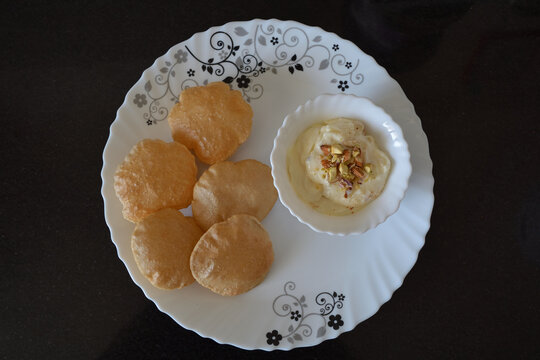Shrikhand-puri, an Indian delicacy