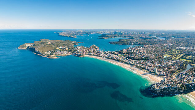 High resolution panoramic high angle drone view of Manly Beach, North Head and the Sydney Harbour area. Manly is a popular suburb of Sydney, New South Wales, Australia. Famous tourist destination.