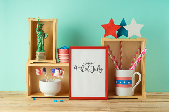 Happy Independence Day, 4th of July celebration concept with photo frame and patriotic home decor on wooden table