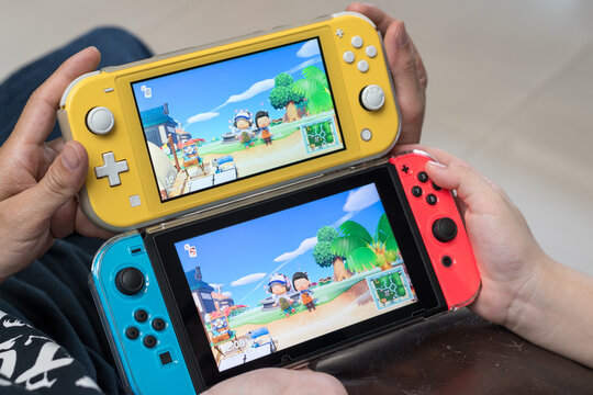 Bangkok,Thailand - May 30, 2020: Animal crossing game popular Nintendo switch with joy controllers family friend activity playing together.